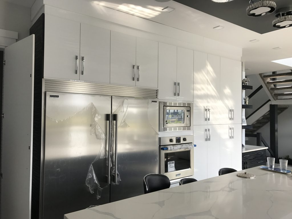 high gloss white and stainless steel kitchen